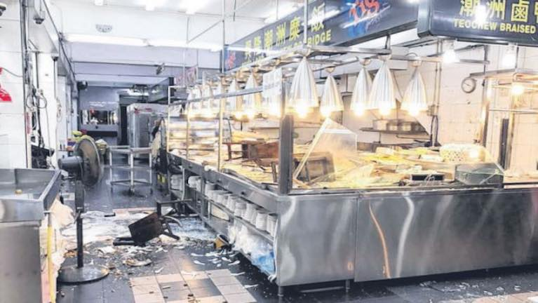 "Singapore ah buhciim ""Porridge"" zuakna ansai ah Customer mi 4 kitom in satzangawp"